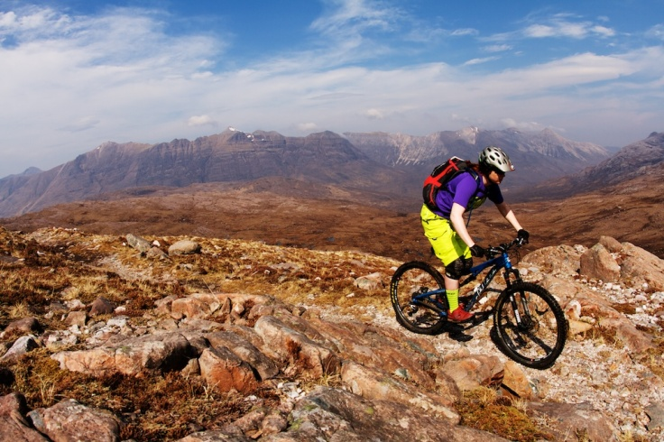Woman mountain biking scotland